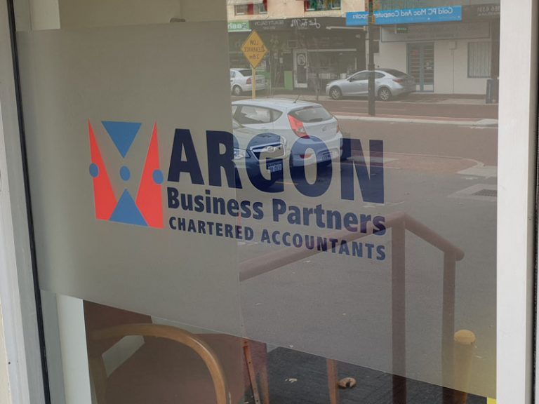 shopfront windo signs with reverse cut vinyl logo backed up with frosted office vinyl.